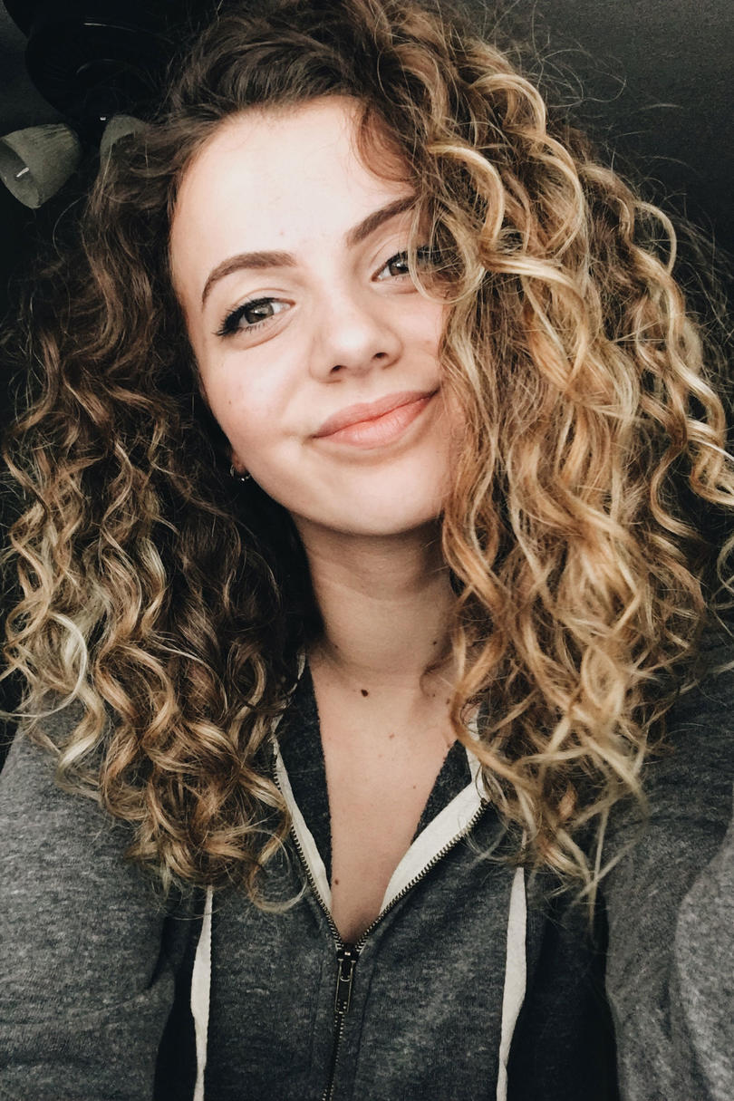 Curly Brown Hair with Blonde Highlights