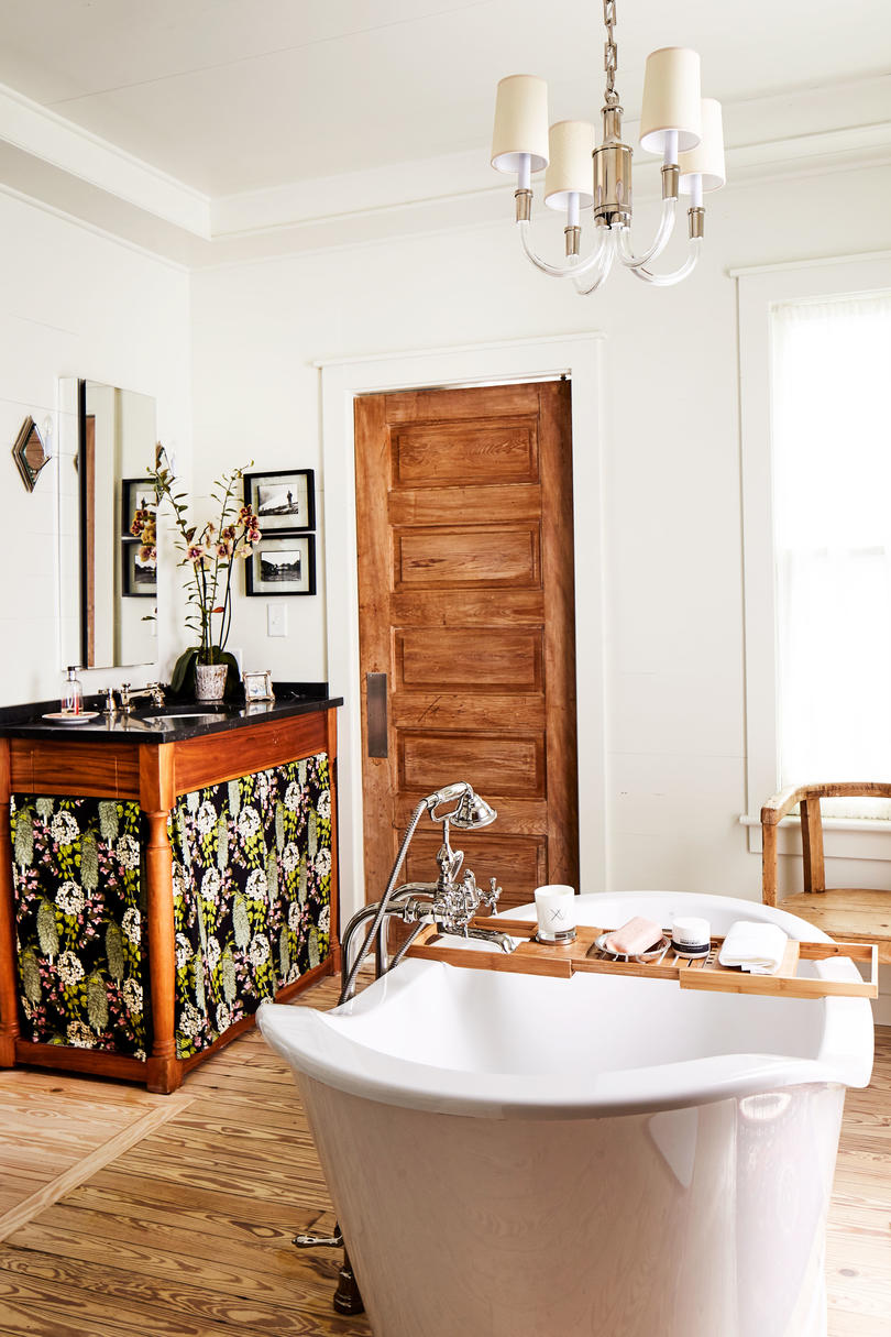 Ginny Stimpson's Fairhope Bay House Master Bathroom with centered soaker tub