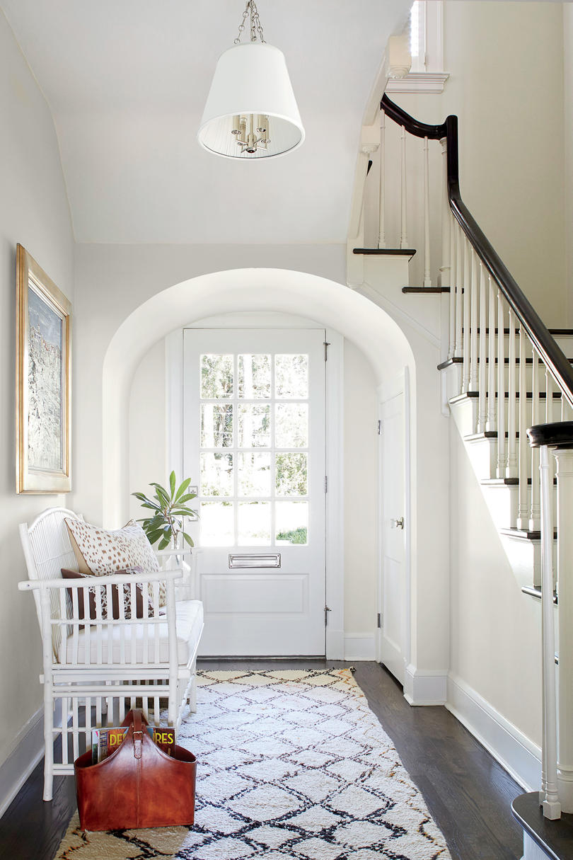 Andrew Howard Colorful Makeover White Entry with Staircase