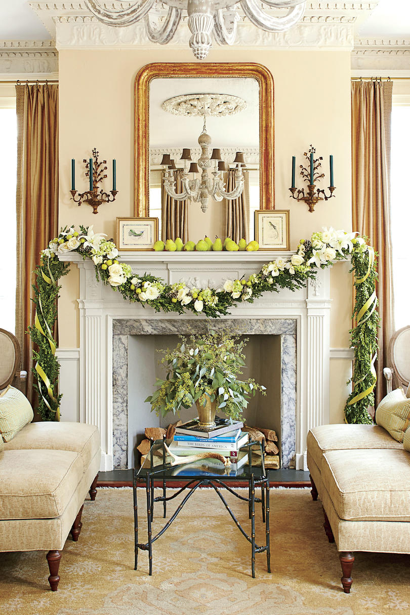 Boxwood Garland with Ribbon and Flowers Around Fireplace Mantel