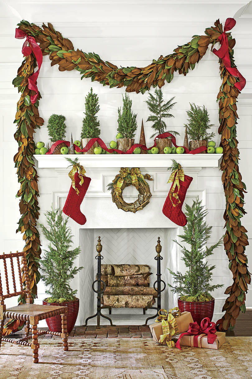 Magnolia Garland and Red Accents Around Fireplace