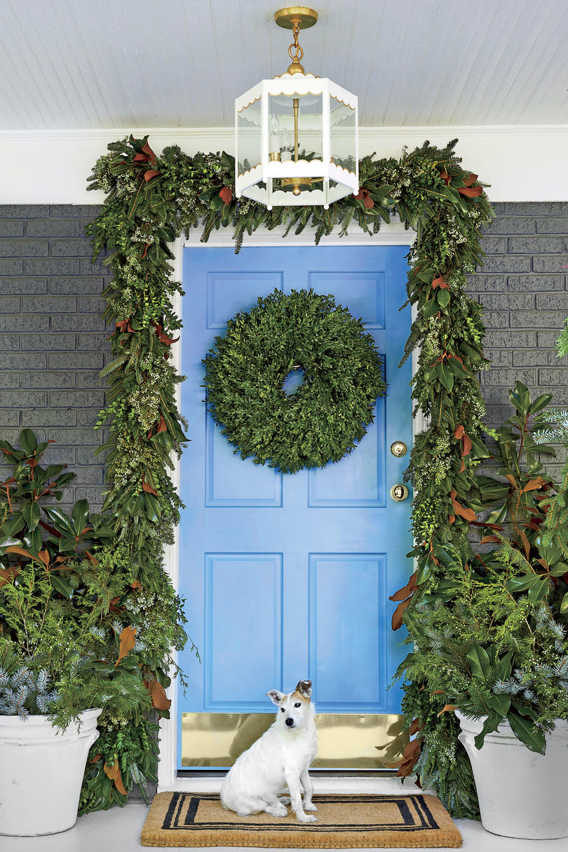 Blue Front Door with Christmas Greenery