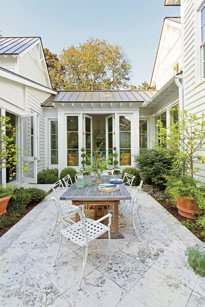 Julia Engel of Gal Meets Glam Charleston, SC Home Courtyard