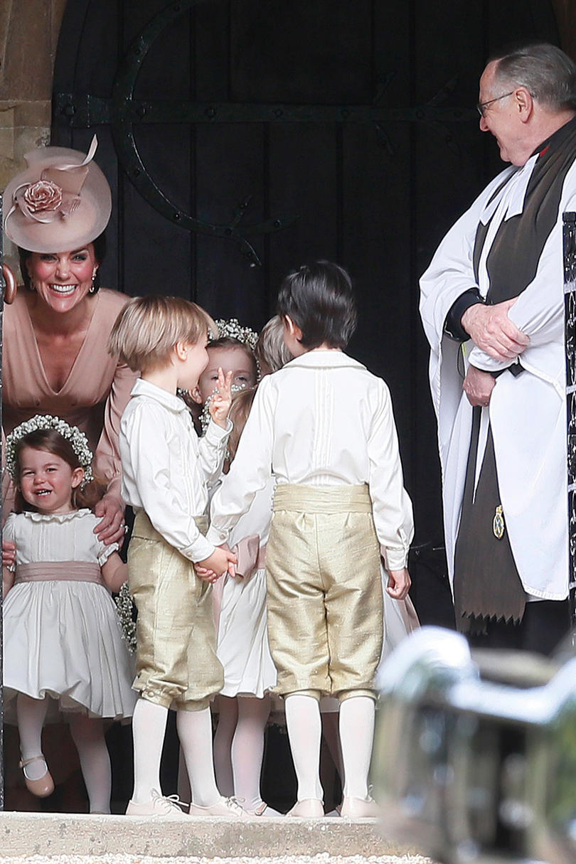 Princess Kate plays with Princess Charlotte before the ceremony