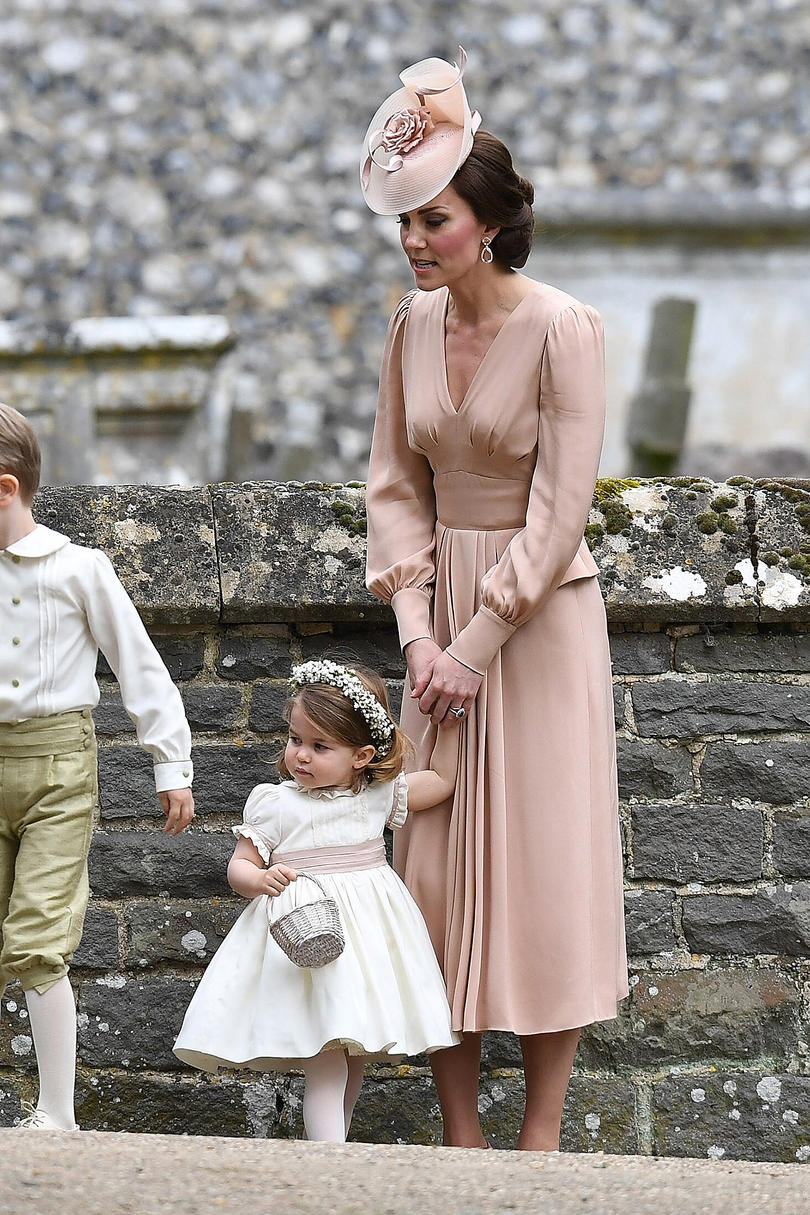 Princess Kate worked herfascinator game (as usual) in a pink-hued floral creation that perfectly matched her dress. And though Princess Charlotte didn't wear a fascinator, she looked lovely in her flower crown.