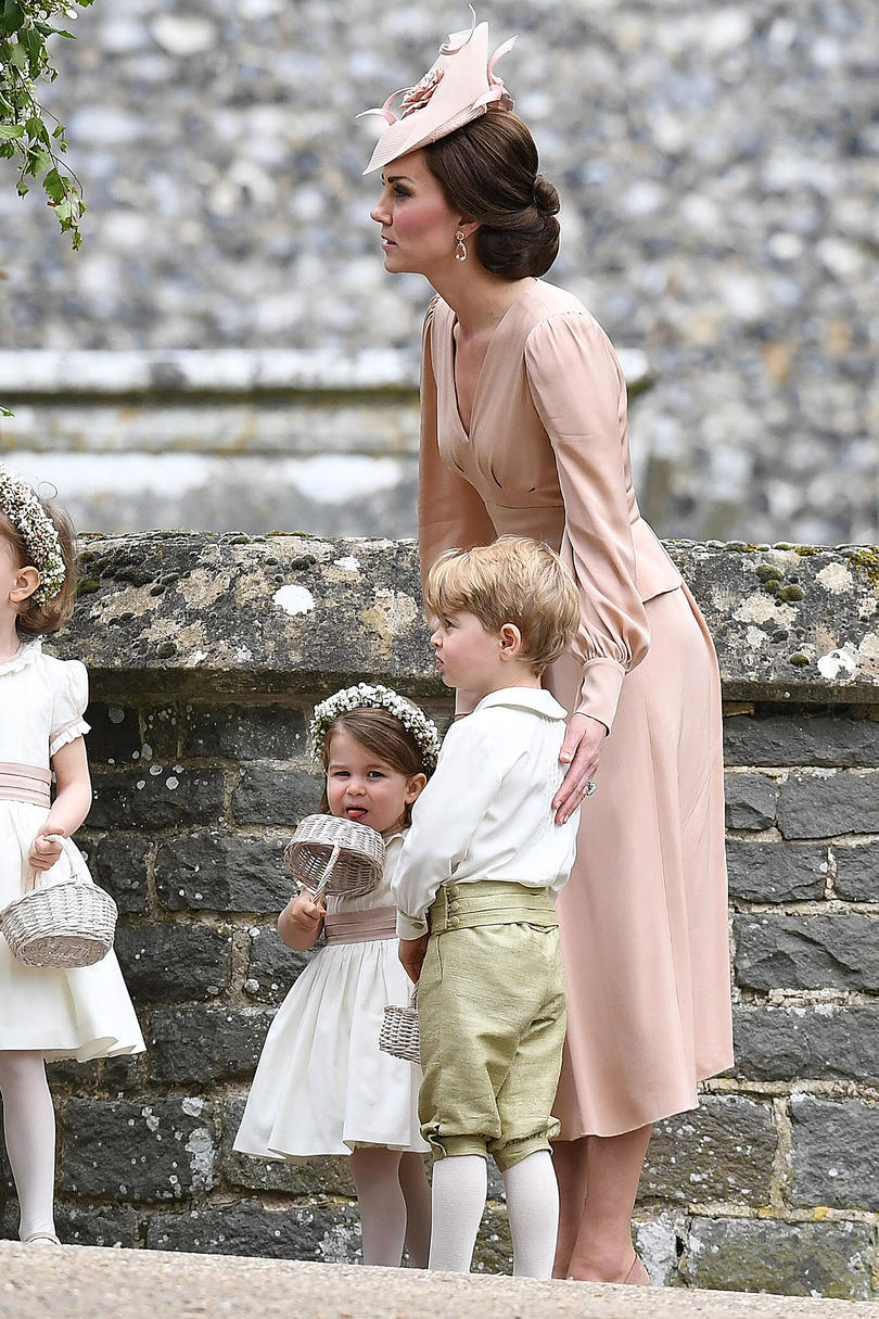 Princess Charlotte sticks out her tongue after the ceremony