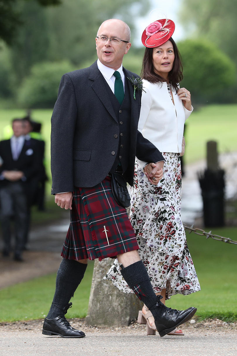 We love this red fascinatoron this guest— but we just might love her date's tartan kilt more!