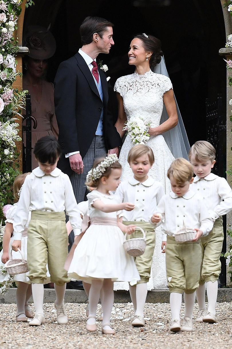 Prince George walks in front of Pippa Middleton and James Matthews after the ceremony
