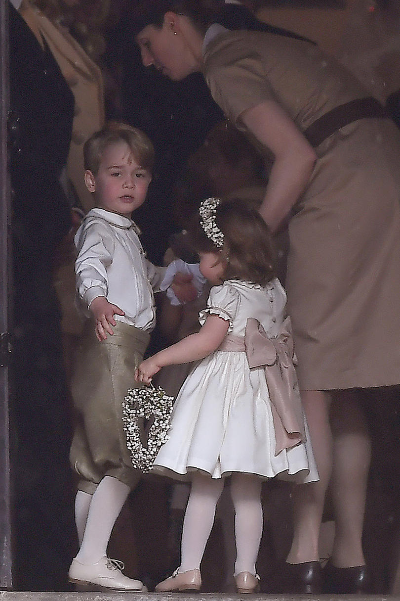Prince George and Princess Charlotte enter the church