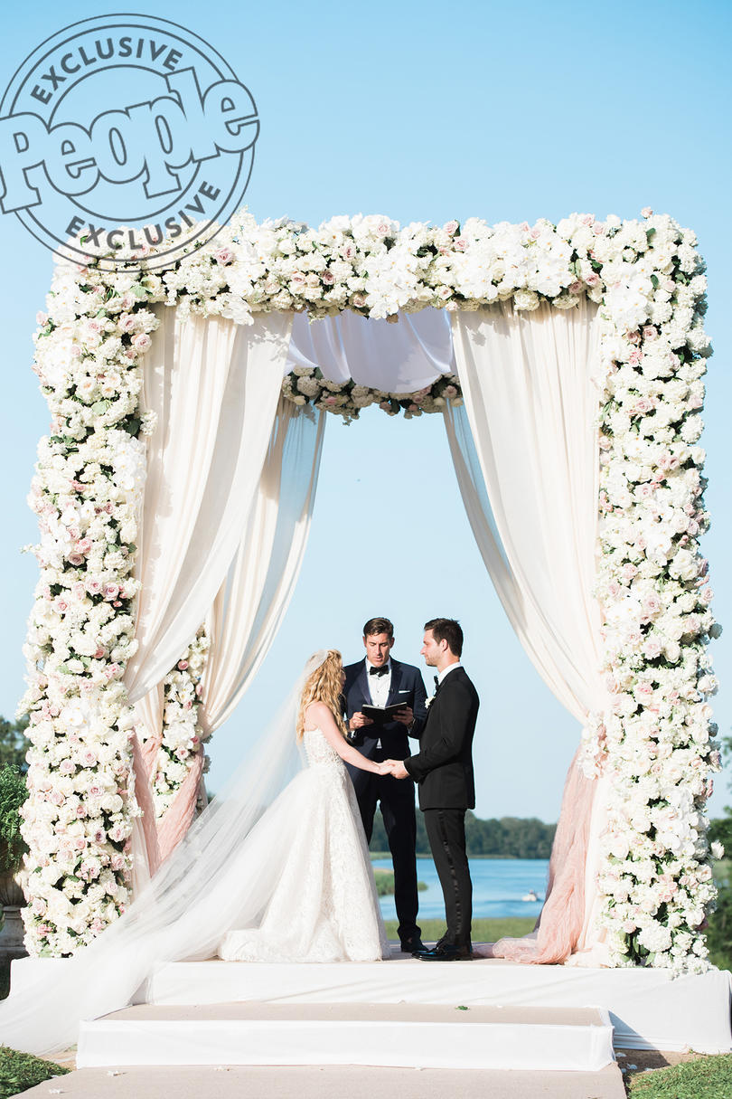 They Exchanged Handwritten Vows Under Thousands of Flowers