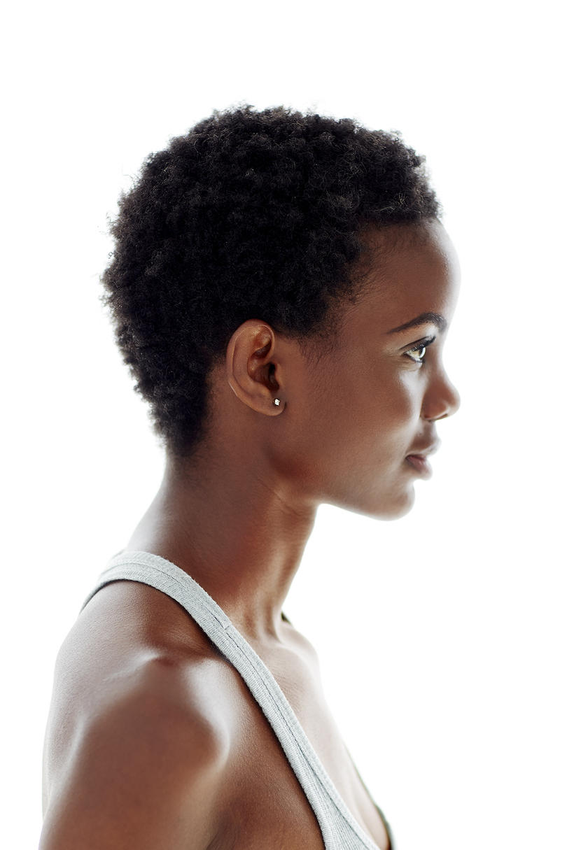 Model with short hair and glowing skin