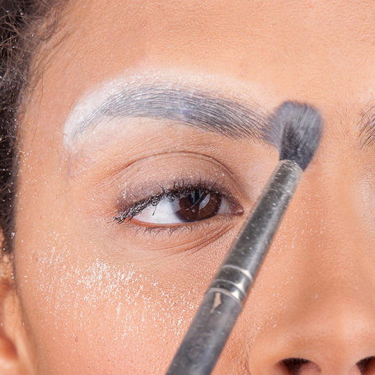 How to glue down eyebrows?