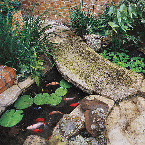 3 courtyard designs southern living for Koi pond design with bridge