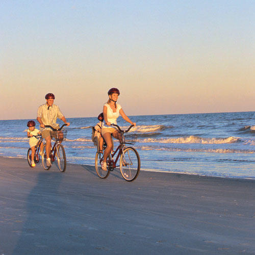 family biking along hilton head island
