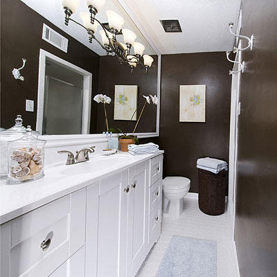 Deep Chocolate Walls Of This Renovated Bathroom Offset The Crisp, White  Bathroom Cabinets And The