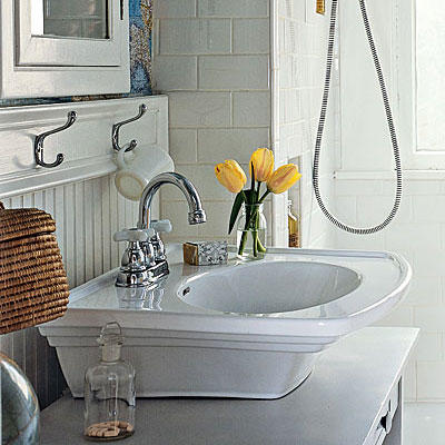 elevated white sink with a steel faucet and beaded board walls in a renovated bathroom project