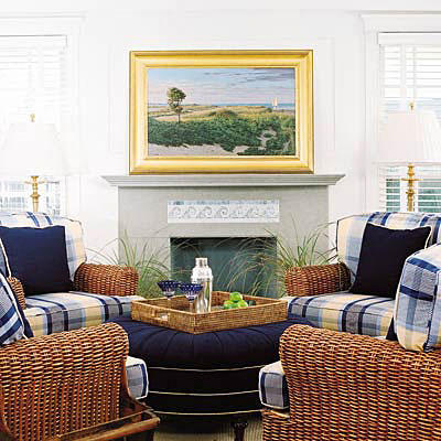 Two Windows Flank Each Side Of The Fireplace With A Gray Hearth Also White