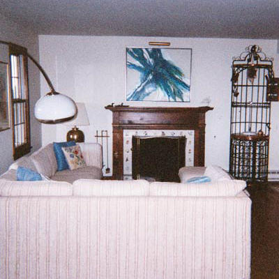 dark wood hearth surrounds fireplace and low ceilings make this family room look dark
