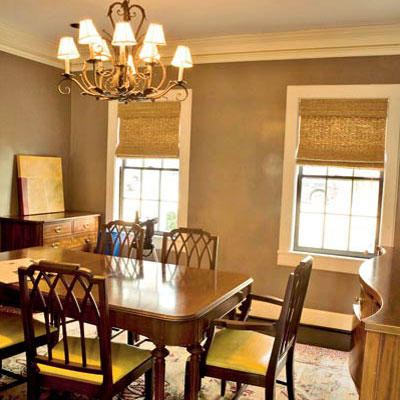 taupe walls, traditional dining room table and natural, bamboo roll up shades