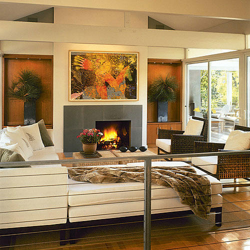 Modern, Sleek Living Room With A Wraparound White Couch Which Faces A  Fireplace. The