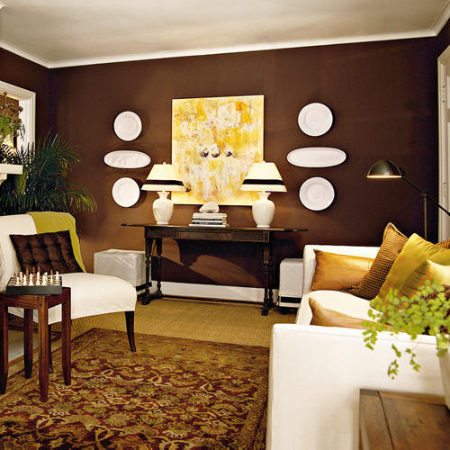 Sitting room with a white couch, brown walls, and accented in cream colors