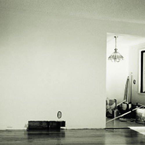empty living room with white walls