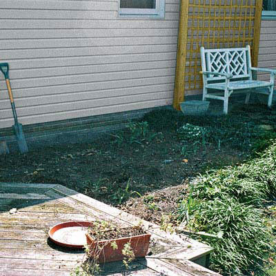 before photo of a backyard with no landscaping in place