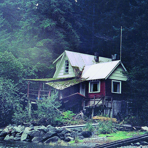 run-down cabin with a sloped roof on top of the deck