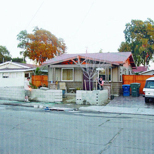 before photo of a tan bungalow home