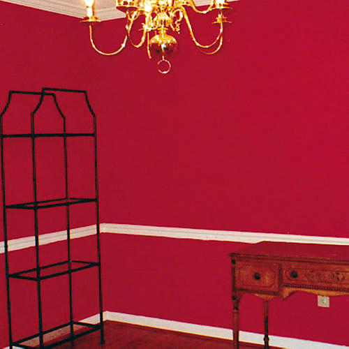 before photo of a red painted dining room with spare furnishings