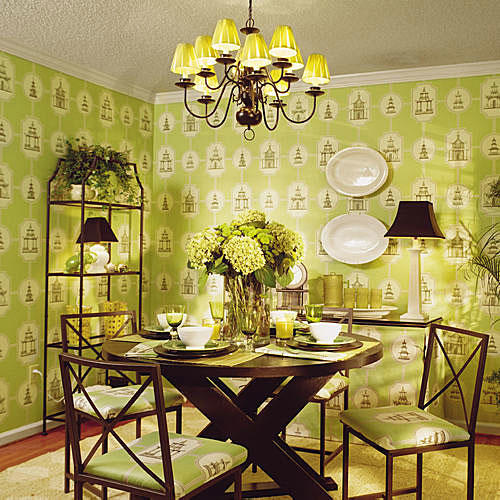 after photo with a dining room that's wallpapered in pale, green Asian designs, and a dark wood dining room table in the middle of the room set with china (and chairs surrounding it).