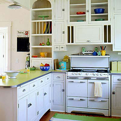 country kitchen with a white wood cabinets and silver door handles