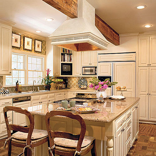Creamy Kitchen Cabinets That Also Covered The Front Of The Refrigerator,  Dish Washer, And