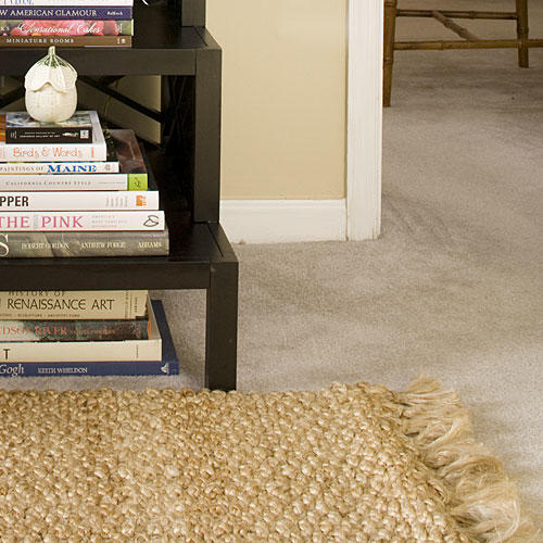 Apartment Decorating: Layer Rugs Over Carpet