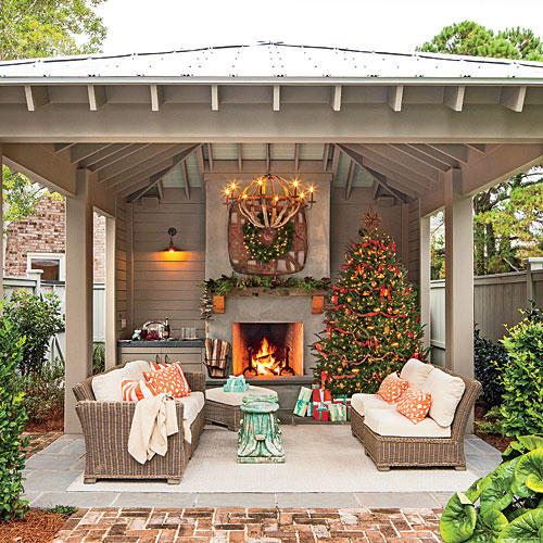 Glowing outdoor fireplace ideas southern living for Covered porch with fireplace