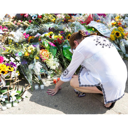 Flowers and Mourner