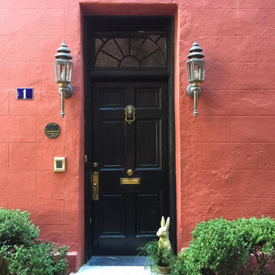Black Door Inset in a Salmon Painted Wall