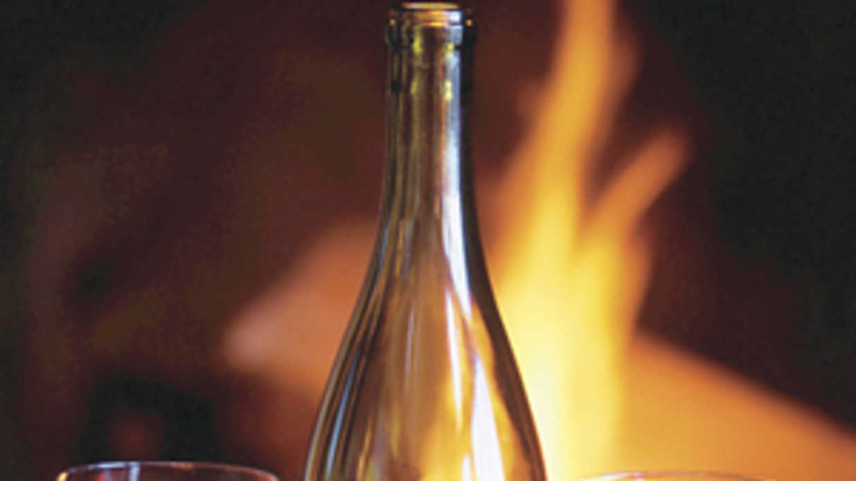 bottles of wine by a fire