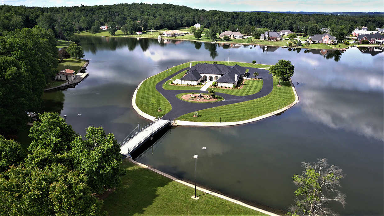 A House on a Private Island in the Middle of the Suburbs? For Less Than $1 Million? Believe it.