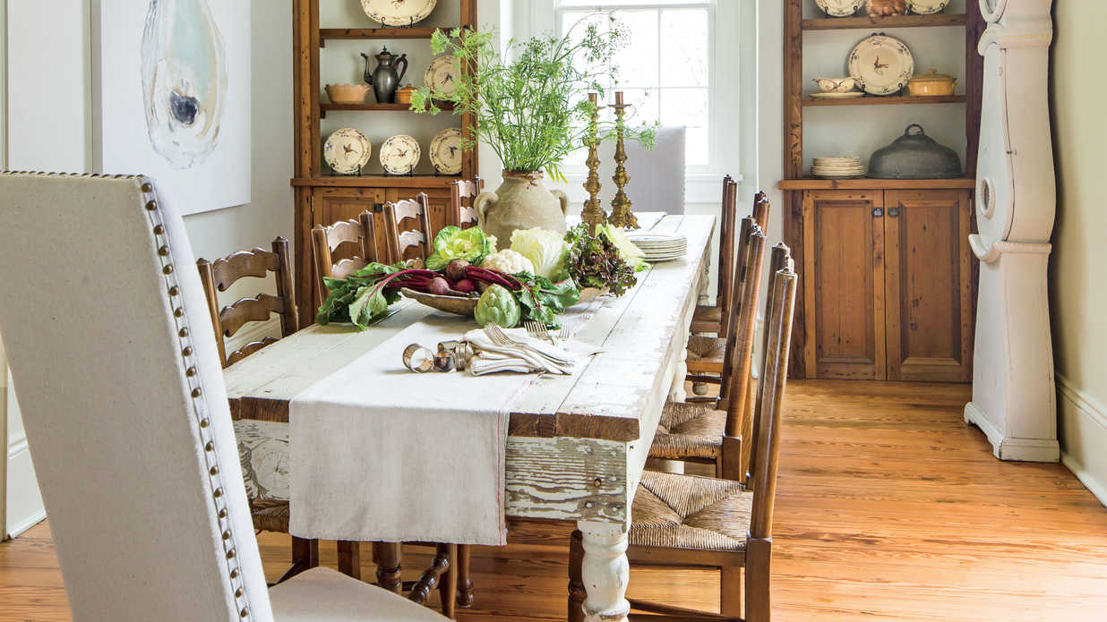 Layer neutrals for a relaxed look stylish dining room for Pictures of dining room tables decorated