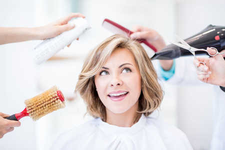 Woman Smiling In Salon Chair